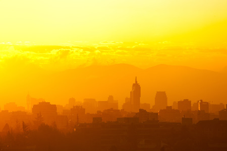 Silhouetted skyline of downtown at sunset, Santiago, Chile