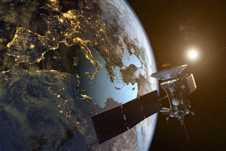 3D rendering of a satellite orbiting the earth with illuminated cities at night