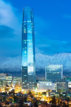 Santiago, Region Metropolitana, Chile - June 12, 2014: Costanera Center skyscraper raise above the Financial district skyline with Los Andes Mountains in the back, Las Condes district. Editorial