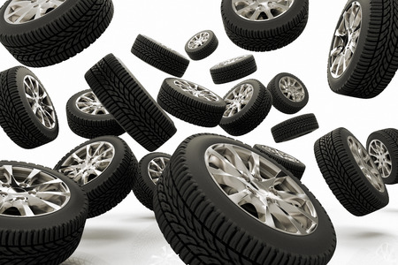 A large group of tires against a white background