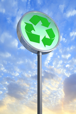 3D rendering of a recycle sign against the sky