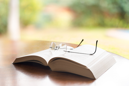 Reading glasses on top of a book