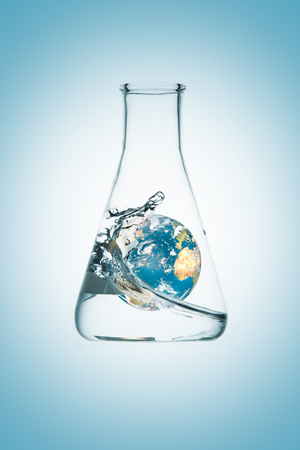 3D rendering of planet Earth under a wave inside a flask