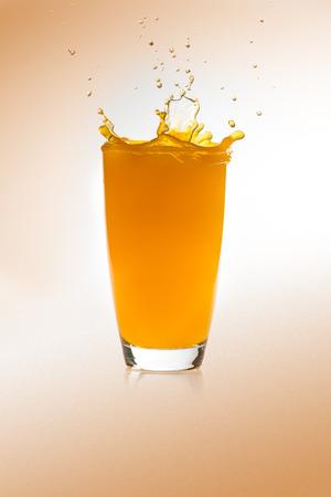 Splash on a glass of orange juice