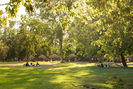 Santiago, Region Metropolitana, Chile - December 28, 2018: People enjoying a summer evening in Padre Hurtado Park at La reina district.