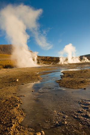 Frozen water and fumaroles at an altitude of 4300m, El Tatio Geysers, Atacama desert, Antofagasta Region, Chile, South America Stock Photo