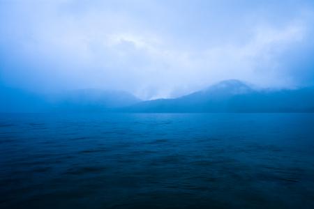 Clouds mist over Caburga lake, southern Chile, Araucania Region, Chile, South America Stock Photo