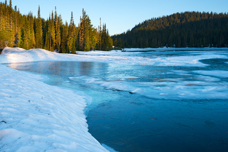 Frozen Reflection Lake at sunrise, Mount Rainier National Park, Washington State, USA