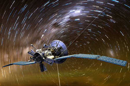 3D rendering of a satellite aginst star trails Stock Photo