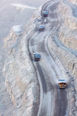 Huge dump trucks in a copper mine in Chile