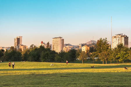 Santiago, Region Metropolitana, Chile - November 19, 2018: People enjoying a summer evening in Parque O? Higgins at downtown. Editorial