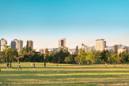 Santiago, Region Metropolitana, Chile - November 19, 2018: People enjoying a summer evening in Parque O? ?? Higgins at downtown. Editorial