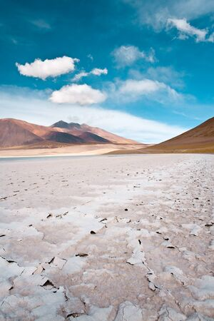Tuyajto lagoon and salt lake in the Altiplano over 4000 meters over the sea level with salt crust in the shore, Los Flamencos National Reserve, Atacama desert, Antofagasta Region, Chile, South America