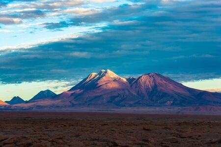 Volcano in the Atacama Desert at sunset, San Pedro de Atacama, Atacama desert, Chile, South America Фото со стока
