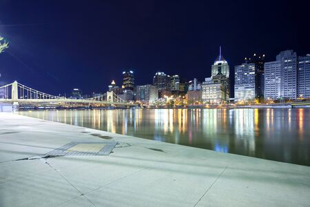 Downtown skyline and Roberto Clemente Bridge over Allegheny River, Pittsburgh, Pennsylvania, USA