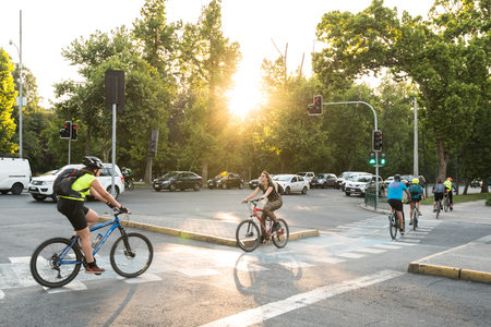 Santiago, Region Metropolitana, Chile - December 11, 2018: People riding bicycle in the Forestal Park, the more traditional urban park in the city. Редакционное