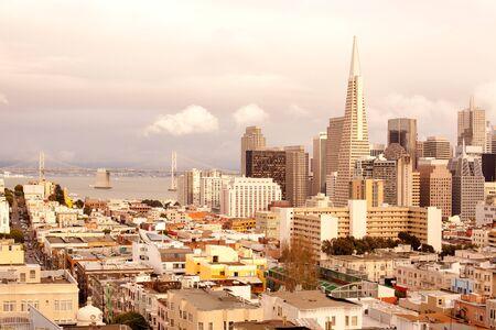 Financial District, North Beach neighborhood and San Francisco-Oakland Bay Bridge, San Francisco, California, USA Фото со стока