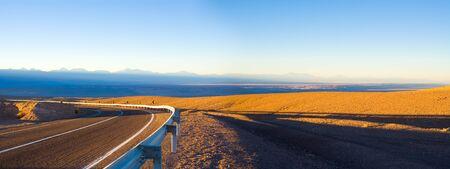 Access road and panoramic view of Atacama Salt Lake (Salar de Atacama) and San Pedro de Atacama village, Atacama Desert, Chile