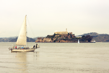 San Francisco, California, United States - March 19, 2012: Sailboats on San Francisco Bay around Alcatraz prision.