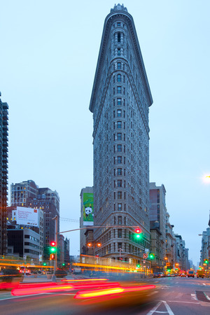 New York City, NY, United States - April 20, 2011: Traffic in front Flatiron Building at Flatiron District at dawn.
