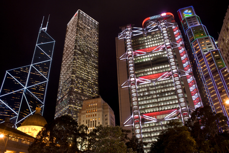 Hong Kong, Admiralty, China - December 03, 2008: skyline of corporate buildings with the Bank of China designed by architect IM Pei and the HSBC building designed by architect Norman Foster from the Statue Square. Редакционное