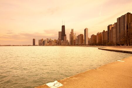 Skyline of downtown and lake MIchigan at dawn, Chicago, Illinois, United States. Фото со стока