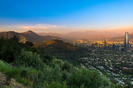Panoramic view of Santiago with Parquemet Metropolitan park and Cerro Manquehue at sunset, Santiago de Chile, Chile