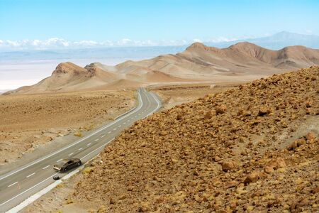 3D rendering of a car failure in a remote road in the Atacama desert.