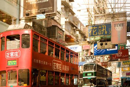 Causeway Bay, Hong Kong Island, Hong Kong, China - Traditional tram and store signs in a street view. Editorial