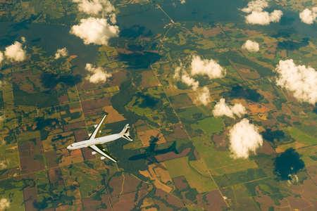 3D rendering of an airpline on flight over the land. Reklamní fotografie