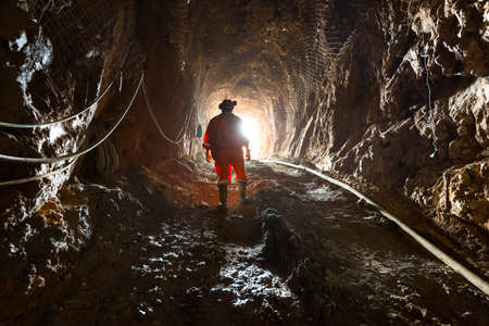 Region del Maule, Chile - Miner inside the access tunnel of an underground gold and copper mine. 新闻类图片