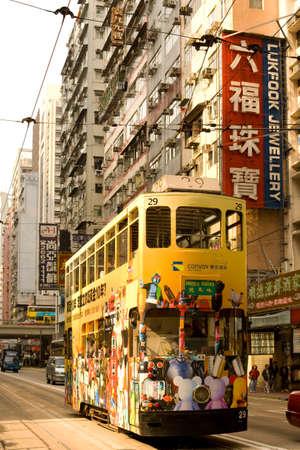 Causeway Bay, Hong Kong Island, Hong Kong, China - Traditional tram and store signs in a street view.