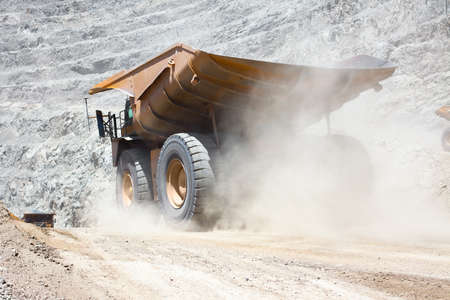 Dust raised by a dump truck at a copper mine.