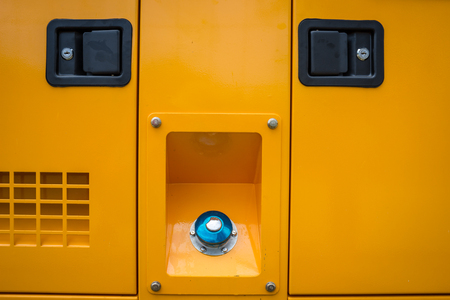 outage: Color picture of a Mobile diesel generator front doors Stock Photo