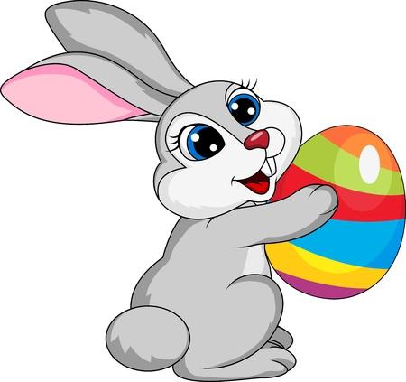 easter bunny: Cute rabbit holding ester egg