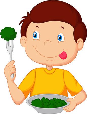 salads: Cute little boy eats vegetable using fork