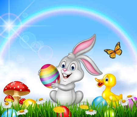 duck egg: Happy little bunny holding an Easter egg with nature background