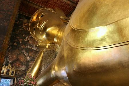 bangkok temple: Sleeping Buddha at Bangkok Temple Stock Photo