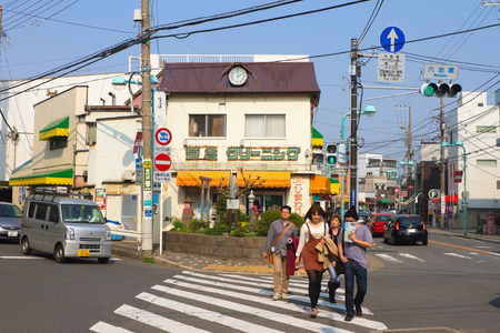 kanagawa: KAMAKURA, JAPAN - MARCH 10: People are crossing the street on March 10, 2013 in Kamakura, Japan. Kamakura is a city located in Kanagawa Prefecture, about 50 kilometres south-south-west of Tokyo. It is a popular tourist destination.