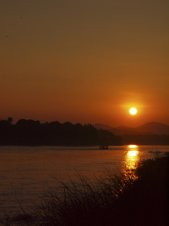 indent: sunset at the sand bar- island of Mekong river