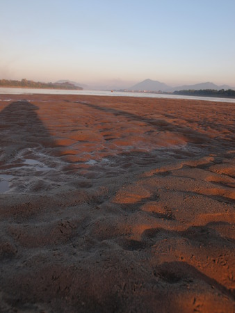 indent: The sand bar in Mekong river in the evening
