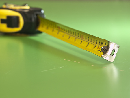 centimetre: The measurement tape in green background Stock Photo