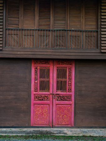 wooden partition: Red Chinese-style gate, installed in the old wooden houses of Thailand.