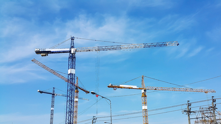 The crane is under construction and there is a clear blue sky behind.