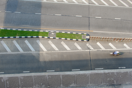 High angle view of the road with traffic lane dividers and barriers to facilitate traffic. Stok Fotoğraf