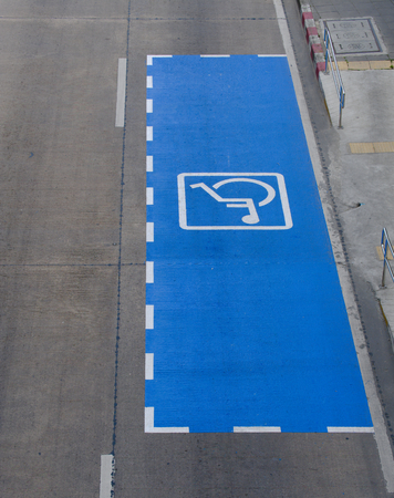 Parking symbol for the disabled on a city street