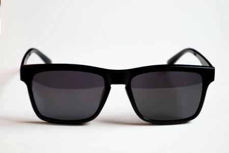 Black sunglasses, black frame isolated on a white clean background. Banco de Imagens
