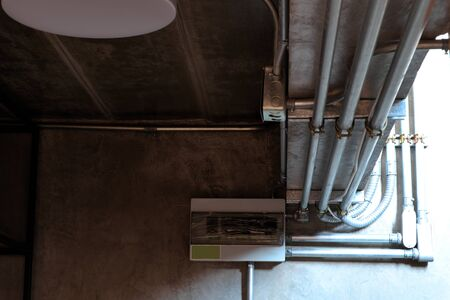 Electrical wiring work in a steel pipe of a house with a loft style decoration design.
