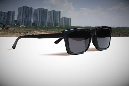 Abstract illustrations meaning  the vision of leader by  the image of the sunglasses and tall building construction and city development background.