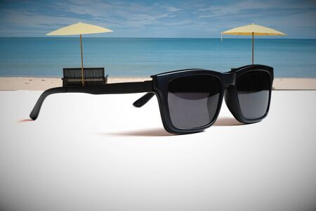 Illustrations that convey the meaning of good summer travel with images of sunglasses and beautiful beach.
